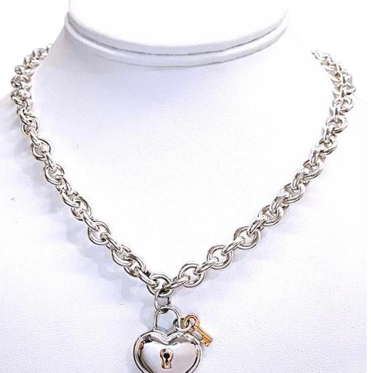 Tiffany & Co. RARE AND RETIRED!!!! Tiffany & Co. 18 Karat Yellow Gold and Sterling Silver Gold Heart and Lock Charm Necklace 16
