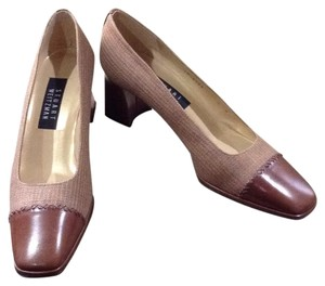 Stuart Weitzman Luggage and tan Pumps