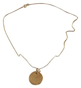 South Moon Under monogram gold chain and charm