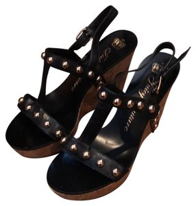 f24e4ba247118 Juicy Couture black with gold hardware and natural cork wedge Wedges