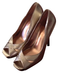 Jessica Simpson Gold with dark wood-panel heel and on small platform under toes Platforms