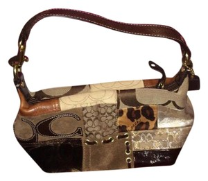 Coach Designer Patterns brown, tan Clutch