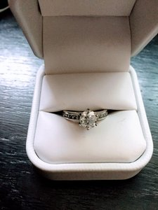 Certified 1.5 Carat Center Stone Solitaire With Side Accent Stones