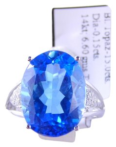 Preload https://item4.tradesy.com/images/white-natural-oval-blue-topaz-wpave-diamond-accent-ring-2040238-0-0.jpg?width=440&height=440