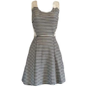 Poof Couture short dress Black Skater Fit And Flare Striped Peekaboo Flare on Tradesy