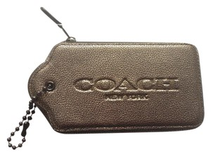 Coach Hangtag Tech Phone Case Gunmetal Wristlet in Brass