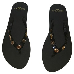 Coach Black and charms in gold Sandals