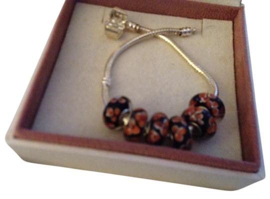 Preload https://item4.tradesy.com/images/bella-and-chloe-black-orange-set-of-6-european-style-murano-lampwork-glass-beads-4mm-hole-bead-charm-2041178-0-0.jpg?width=440&height=440
