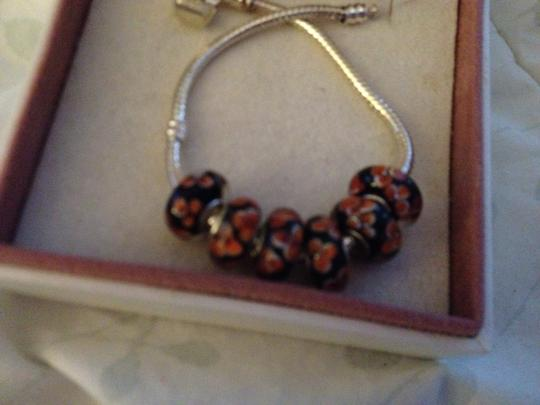 Bella & Chloe SET OF 6 ~~European Style Murano Lampwork Glass Beads, 4mm hole, A Beautiful Bead. Black & Orange.