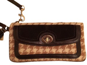 Coach Wristlet in brown, cream, and tan