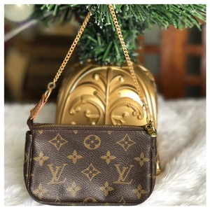 Louis Vuitton Louis Vuitton mini Pochette wristlet
