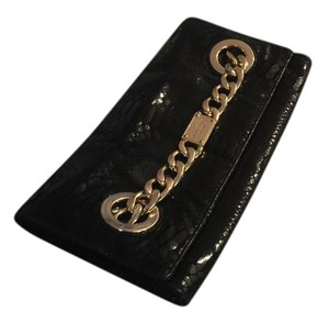 Michael Kors Black Michael kor clutch with gold chain in excellent confition