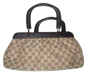 Gucci Rare Frame Satchel in brown canvas with large G logo burnt orange leather and wood