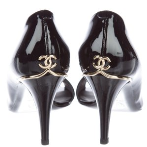 Chanel Interlocking Cc Patent Leather Logo Peep Toe Gold Hardware Black Pumps