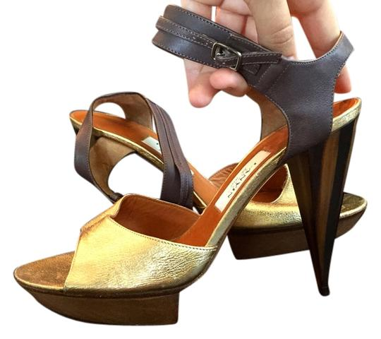 Preload https://item2.tradesy.com/images/lanvin-gold-and-brown-horn-heal-with-leather-ankle-strap-stiletto-platforms-size-us-10-regular-m-b-2042401-0-0.jpg?width=440&height=440