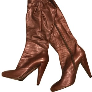Miu Miu brown with gold bottoms Boots