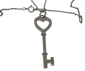 Tiffany & Co. 18k white Gold Diamond heart Key Pendant & 16