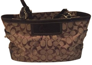 Coach Tote in Brown cloth with brown leather detailing. Beautiful lilac cloth interior.