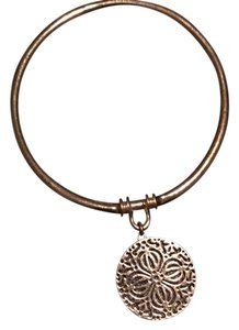 Other gold bangle with dangle charm