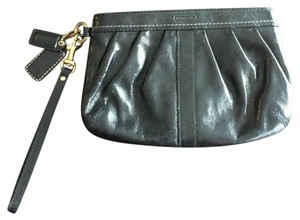 Coach Wristlet in black with gold brass tone hardware