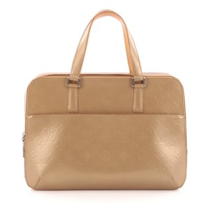 Louis Vuitton Leather Satchel in Gold