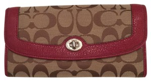 Coach coach black cherry and khaki turnlock