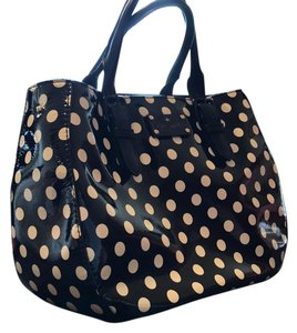Kate Spade Satchel in Black with white polka dots with a semi gloss finish