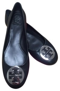 Tory Burch black with silver emblem Flats