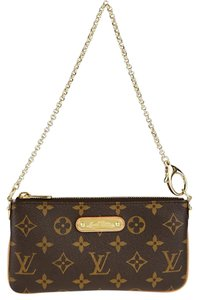 Louis Vuitton Wristlet in Monogram canvas