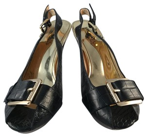 MICHAEL Michael Kors Black and Gold Platforms