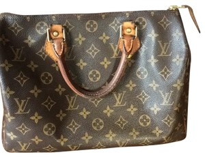 Louis Vuitton Satchel in brown with honey colored vachetta leather
