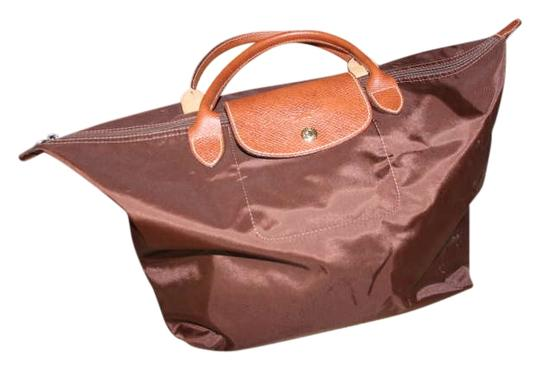 Preload https://item1.tradesy.com/images/longchamp-le-pliage-medium-tote-brown-leather-and-nylon-weekendtravel-bag-204625-0-0.jpg?width=440&height=440