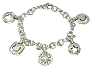 Tiffany & Co. Authentic Tiffany &Co. Sterling silver 5 charm bracelet.