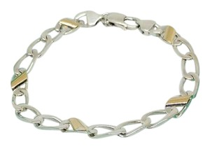 Tiffany & Co. RETIRED!! RARE!!! Tiffany & Co. Cuban Link 18 Karat Yellow Gold and Sterling Silver Bracelet 7