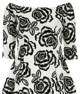 Glamorous short dress Black and white Rose Petal Print on Tradesy