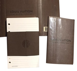 Louis Vuitton pages and address book for small organizer.