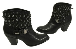 Stuart Weitzman Fine Lining Zippers Round Black leather covered with silver and pewter metal rounded grommets ankle Boots