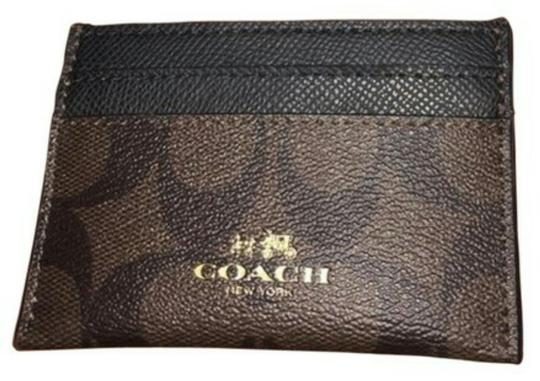 Preload https://img-static.tradesy.com/item/20470666/coach-brown-and-black-card-case-wallet-0-0-540-540.jpg