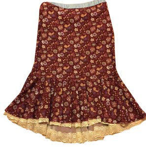 Free People Skirt Burgundy with blue flowers.