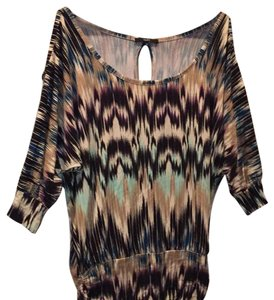 Tart Top multicolored including mint green, purple hues, black and light brown