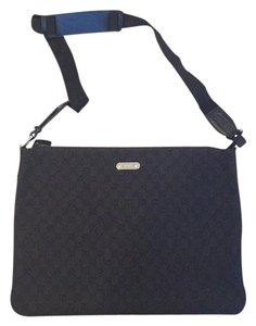 Gucci Tote in Black canvas and black trim and adjustable shoulder strap