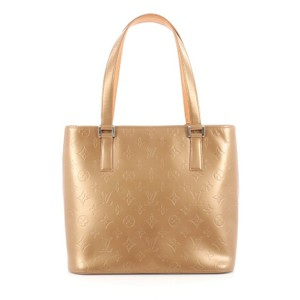 Louis Vuitton Leather Tote in Gold