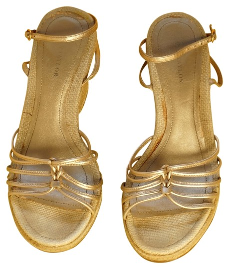 Preload https://item4.tradesy.com/images/ann-taylor-gold-summer-comfortable-wedges-size-us-8-regular-m-b-2048938-0-0.jpg?width=440&height=440