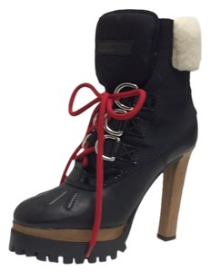 Dsquared2 Black with tan leather heel. Boots