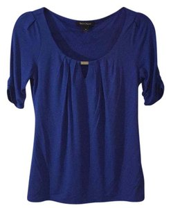 White House | Black Market Top Cobalt blue with silver detail.