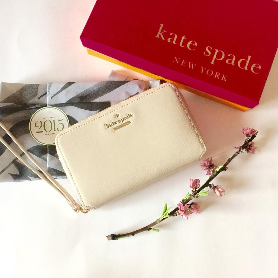 detailed pictures 5c28e ac2a8 Kate Spade Beige Wallet/Wristlet Tech Accessory 39% off retail