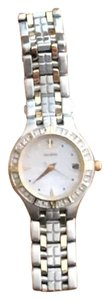 Citizen Citizen Gold/Stainless Steel 2 Tone Mother of Pearl W/Crystal Bezel.
