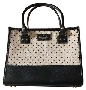Kate Spade Satchel in Black polka dot & creamy off white interior is red