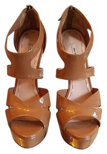 Miu Miu Tan patent cutout sandal. Missing one pull tab on right shoe. Over all great condition Platforms