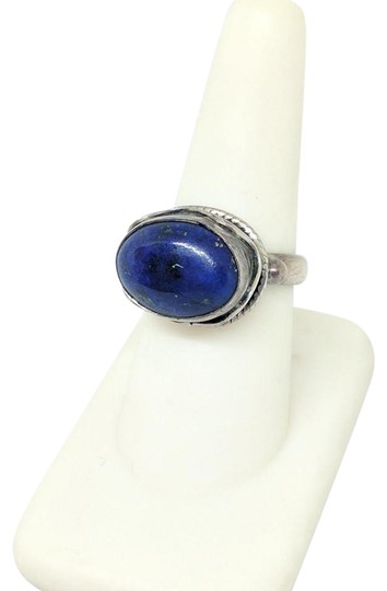 Preload https://img-static.tradesy.com/item/20503092/sterling-silver-79-grams-size-7-with-blue-soldalite-ring-0-1-540-540.jpg
